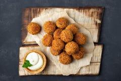 Vegetarian chickpeas falafel balls on wooden rustic board royalty free stock photos