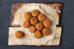 Vegetarian chickpeas falafel balls on wooden rustic board royalty free stock image