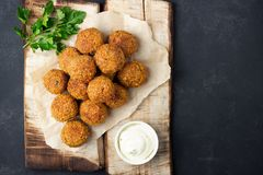 Vegetarian chickpeas falafel balls on wooden rustic board royalty free stock images