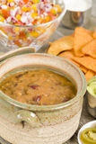 Vegetarian Chili. Chili made with soy protein and beans served with tortilla chips, pico de gallo, jalapenos, guacamole and sour cream Stock Image