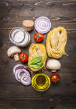 Vegetarian concept cooking pasta with vegetables and mushrooms on wooden rustic background top view close up Stock Photo