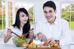 Vegetarian couple make salad Royalty Free Stock Photography