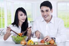 Vegetarian couple preparing healthy food Royalty Free Stock Image
