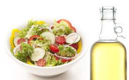 Vegetarian cousine. Dish with salad,peppers,tomatoes,onions isolated on white background Stock Photos