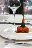 Vegetarian creative food in luxurious restaurant. Tomatoes in sause royalty free stock images