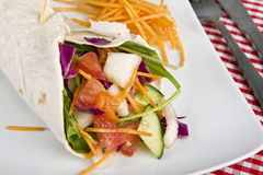 Vegetarian crepe. Veggie wrap filled with various vegetables. Selective focus Royalty Free Stock Photos