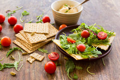 Vegetarian crispbread  with tomatos, cheese and salad mix Stock Photos