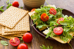 Vegetarian crispbread  with tomatos, cheese and salad mix Stock Image