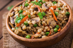 Vegetarian crumbly pearl barley porridge Stock Image