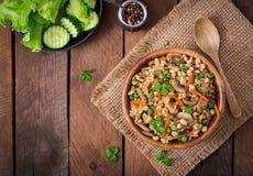 Vegetarian crumbly pearl barley porridge Stock Photography