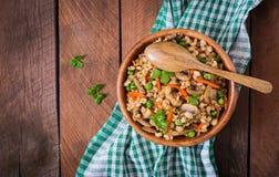 Vegetarian crumbly pearl barley porridge Royalty Free Stock Photo