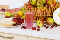 Vegetarian Cuisine: Cornelian cherry compote and lot of fruit. Vegetarian Cuisine: Cornelian cherry compote, Dogwood berries, melon, apples, and lot of fruit and Stock Photography