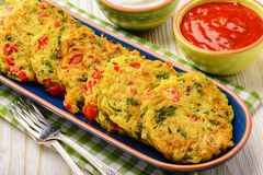 Vegetarian cuisine - vegetable fritters (with potatoes, carrot, zucchini, paprika and parsley). Vegetarian cuisine - vegetable fritters (with potatoes, carrot royalty free stock photo