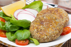Vegetarian cutlets with fresh salad Royalty Free Stock Image