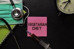 Vegetarian Diet text on top view black table with blood sample and Healthcare/medical concept royalty free stock photos