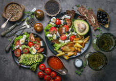 Vegetarian dinner - fried potatoes and fresh vegetable salad. Top view Stock Photography