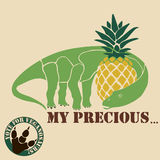 Vegetarian dinosaur. Eating a pineapple and he likes it Stock Photo