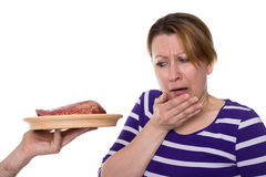 Vegetarian is disgusted for meat Stock Image