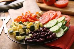 Vegetarian dish. Beans, fried marrows, fresh tomatoes and cucumbers Royalty Free Stock Images