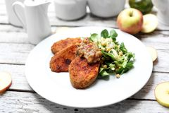 Vegetarian dish. Baked sweet potatoes with chickpea salad stock images
