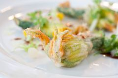 Vegetarian dish of fried Zucchini flowers Stock Photo