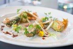 Vegetarian dish of fried Zucchini flowers Stock Photos
