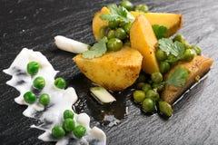 Vegetarian dish with stewed potatoes Stock Photo