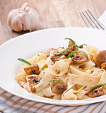 Vegetarian dish with tagliatelle and mushrooms Royalty Free Stock Images