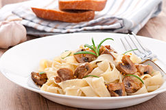 Vegetarian dish with tagliatelle and mushrooms Stock Photography