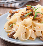 Vegetarian dish with tagliatelle and mushrooms Stock Photo