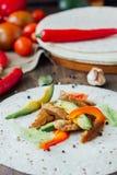 Vegetarian fajitas - traditional mexican food on list of tortilla bread. Vegetarian fajitas - traditional mexican food on list of tortilla bread Stock Image