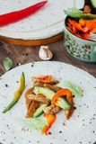 Vegetarian fajitas - traditional mexican food on list of tortilla bread. Vegetarian fajitas - traditional mexican food on list of tortilla bread Royalty Free Stock Images