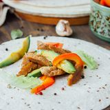 Vegetarian fajitas - traditional mexican food on list of tortilla bread. Vegetarian fajitas - traditional mexican food on list of tortilla bread Royalty Free Stock Photos