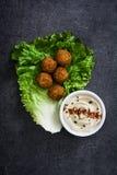 Vegetarian falafels, hummus on slate background Stock Image