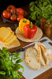 Vegetarian food. Composition of vegetarian food on a wooden table Stock Photos