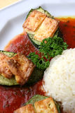 Vegetarian food. A plate of baked zucchini and rice with tomato sauce Stock Photography