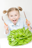 Vegetarian food. Little girl with organic lettuce Royalty Free Stock Image