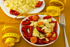 Vegetarian food. Bowl and plate with vegetables on table Stock Image
