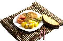 Vegetarian food with bread, on a white plate and on a rug Stock Photos