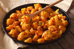 Vegetarian food: Cauliflower in curry sauce close-up. Horizontal Royalty Free Stock Photo