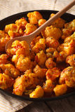 Vegetarian food: Cauliflower in curry sauce close-up. vertical Stock Photos