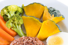 Vegetarian food, contains coarse rice, egg, carrot, pumpkin and Royalty Free Stock Photos