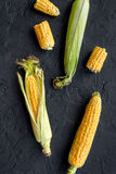 Vegetarian food. Corn cobs on black stone background top view Royalty Free Stock Photography