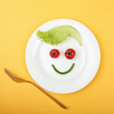 Vegetarian food face. Healthy food still life. vegetarian plate.funny face from vegetables royalty free stock photo