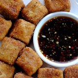 Vegetarian food, fried tofu. Frugal vegetarian food from Vietnamese cuisine, fried tofu with spice power, cover with crispy flour, homemade food on green leaf royalty free stock image