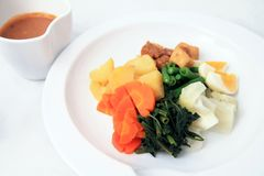 Vegetarian food named gado-gado. On white plate Royalty Free Stock Photo