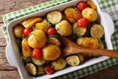 Vegetarian food: new potatoes baked with zucchini, peppers and t Royalty Free Stock Image