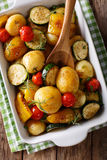 Vegetarian food: new potatoes baked with zucchini, peppers and t Royalty Free Stock Photo