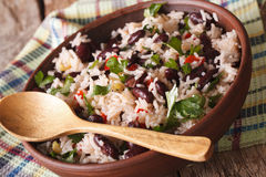 Vegetarian food: rice with red beans in a bowl close-up. horizon. Vegetarian food: rice with red beans in a bowl close-up on the table. horizontal stock photos