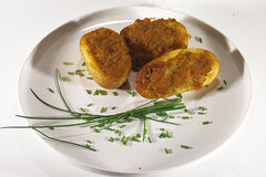 Vegetarian food. Stuffed potatoes with chives Stock Photo